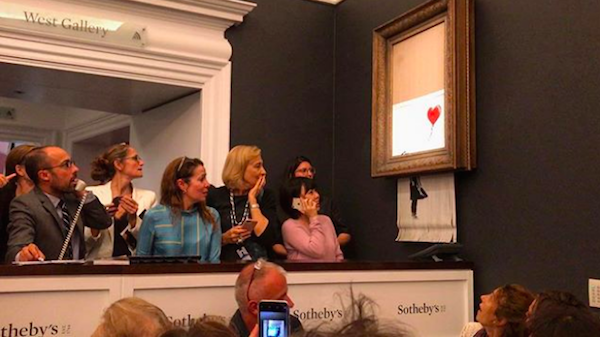 Banksy Artwork Self-Destructs Seconds After Being Auctioned Off For $1.1 Million