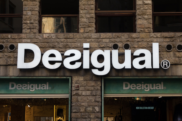 Desigual Permanently Reverses Its Logo To Mirror Its Iconic
