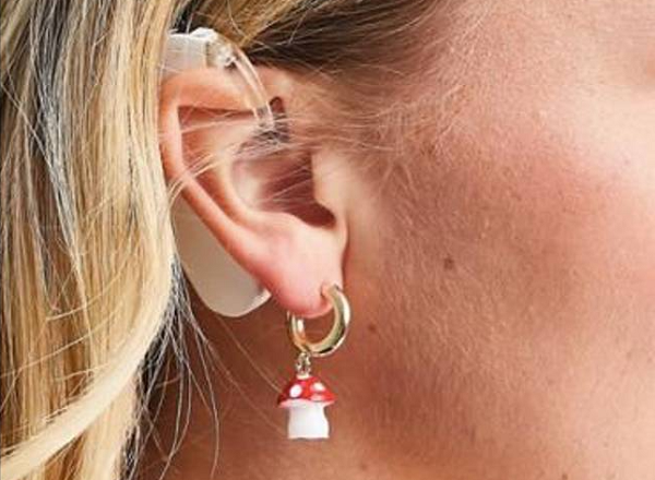 ASOS Applauded For Featuring Model With Cochlear Implants In Earrings Ad