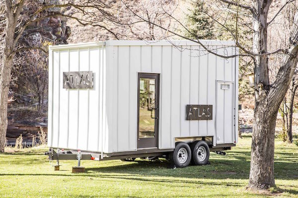 modest 192 square foot eco tiny home hides open deck and