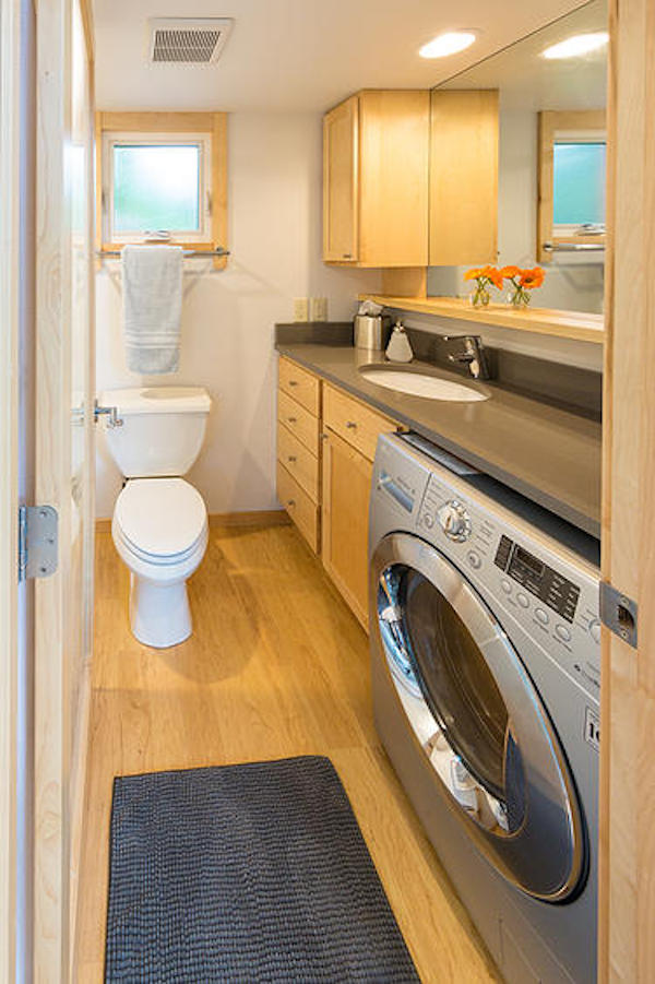 269 square foot handcrafted tiny house contains full size kitchen and bathroom