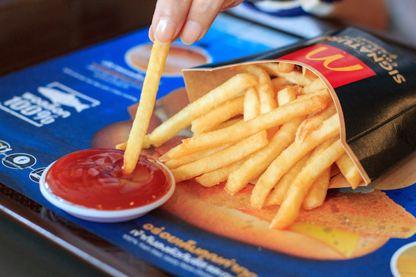 McDonald's Fan Shares Clever Packaging Hack To Hold Ketchup While Enjoying Fries