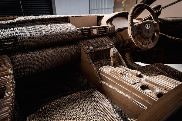 An impressive life sized car made entirely of cardboard for Made design