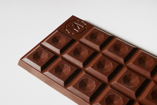 Beautiful Chocolate Bars That Are Wrapped In Unique Pieces Of
