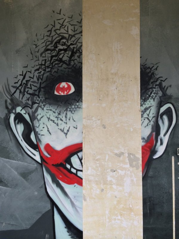 In Belgium, An Abandoned Building That Is Filled With Batman-Themed Graffiti