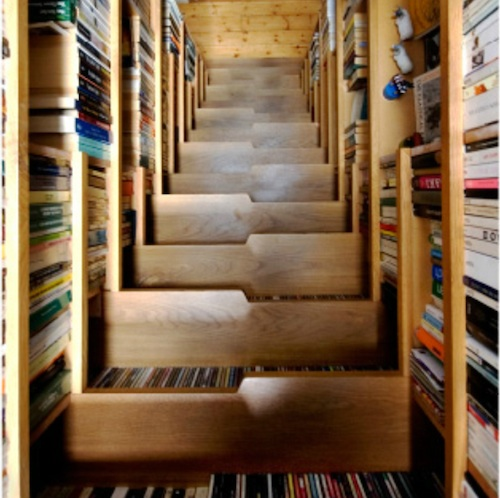"... the whole weight of the stair and books back to the main structural  walls of the building,"" the design studio added. ""It dangles from the upper  floor ... - For Book Lovers, A Staircase That Doubles As A Bookcase"