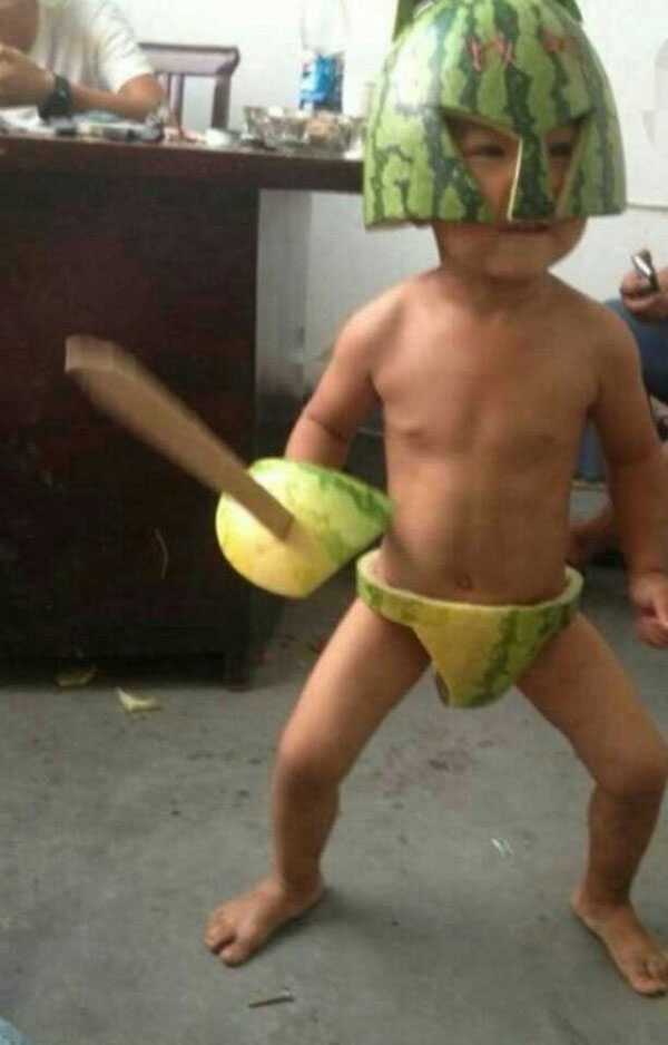 In China Kids Don Suits Made Of Watermelons To Cool Off