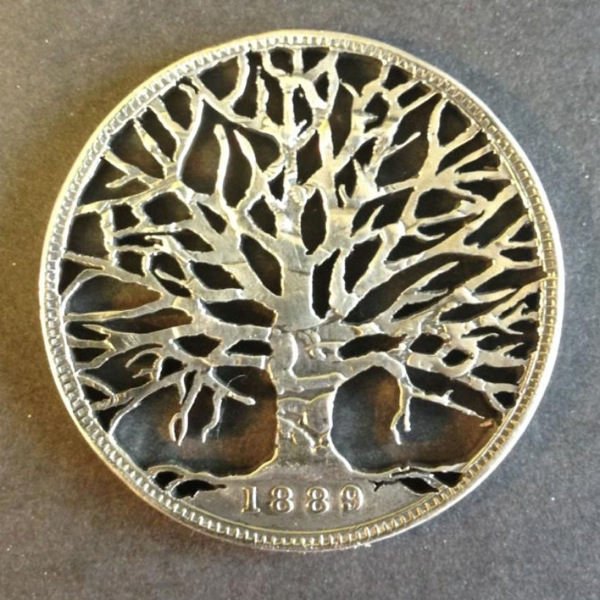 Old Coins Intricately Carved Into Beautiful Jewelry