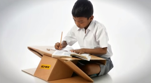 A Portable Desk Made Of Recycled Cardboard Doubles As A