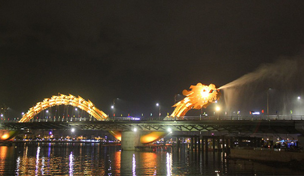 In Vietnam A Fire Breathing Dragon Bridge Designtaxi Com