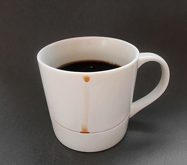 A Cleverly Designed Mug That Catches Your Coffee Drips