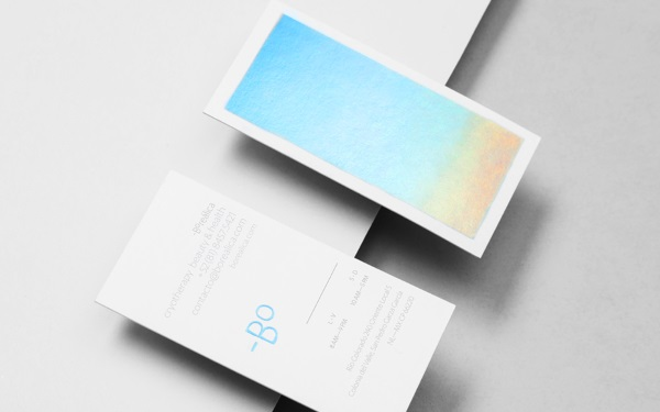 Striking holographic business card changes from one shimmering shade creative agency anagrama has created a minimalist yet striking identity for monterrey based clinic borelica which specializes in using extremely low colourmoves