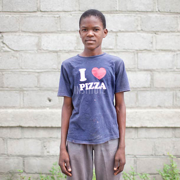 Photographs Of Haitians Wearing Funny T Shirts Donated