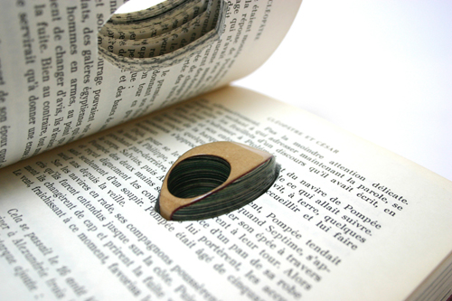 Sure you can give them away for a good cause or drop them in the recycling  bins, but how about turning your old books into jewelry?