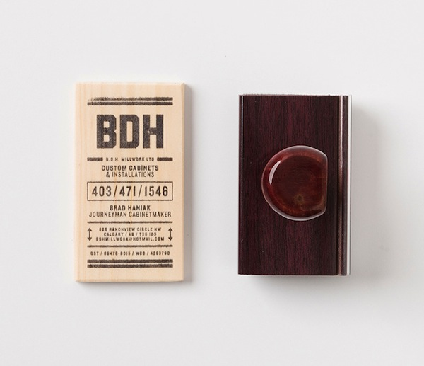 Carpenter rubber stamps business card information onto for Rubber business cards