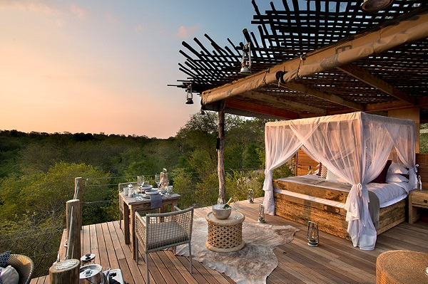A Luxury Safari Resort In South Africa That Overlooks A
