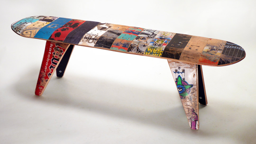 a bench made from recycled skateboard decks