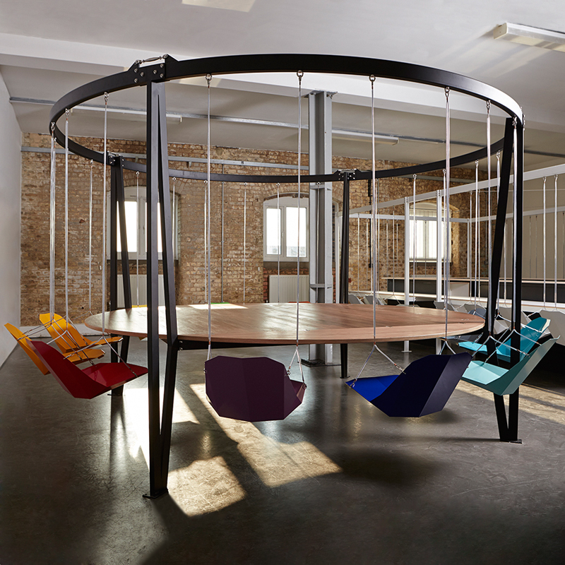 this whimsical swing table will inject some fun into office