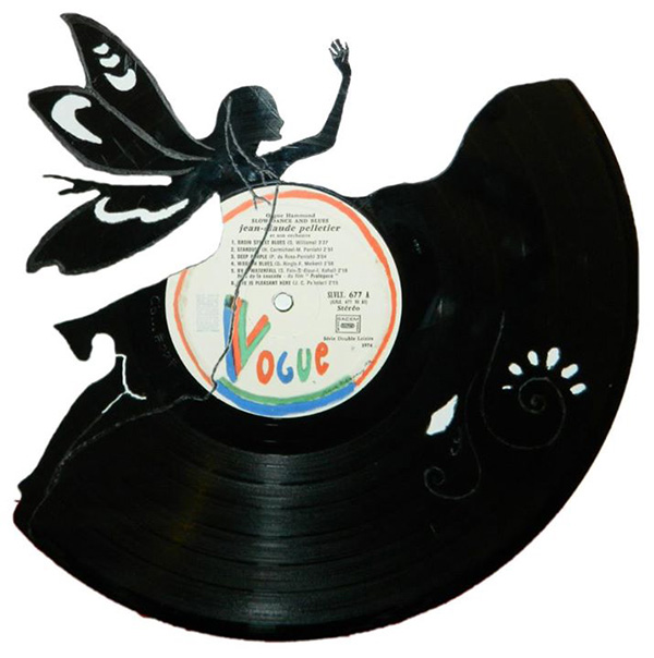 intricate hand cut vinyl record art