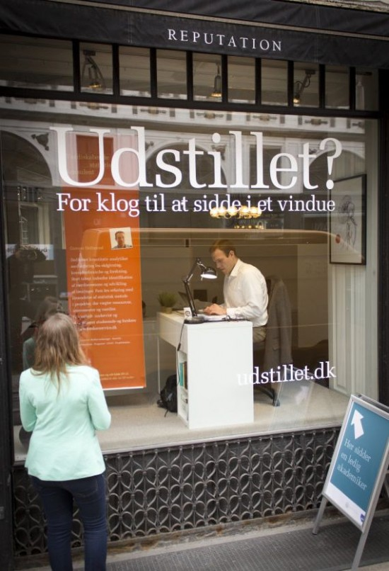 Sit In Window out-of-work job seekers sit in window display, hope to attract