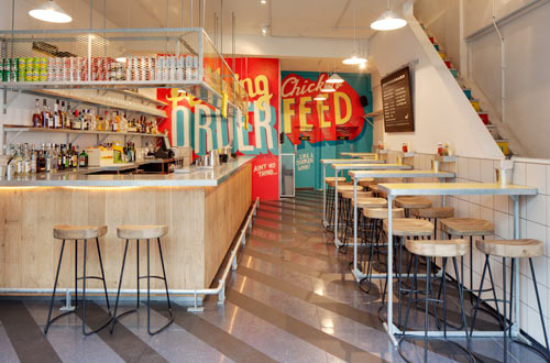 London eatery spruces up with typographic wall murals for Deco restaurant design