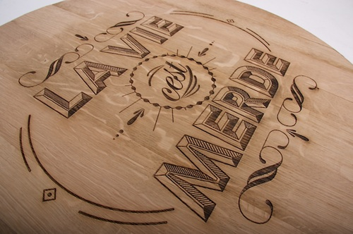 Artist Engraves Typography Onto Wood Using Laser Technique