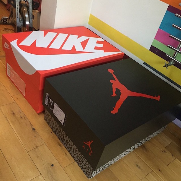 Attractive Designer Builds A Sneaker Cabinet That Looks Like A Gigantic Nike  OM41